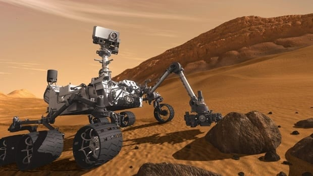 In this artist's rendering, the Mars Science Laboratory Curiosity rover examines a rock on Mars with a set of tools at the end of its arm.