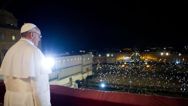 Newly elected Pope Francis appears on the balcony of St. Peter's Basilica after being elected by the conclave of cardinals, in a photograph released by Osservatore Romano at the Vatican, March 13, 2013.