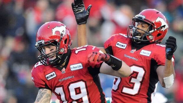Calgary's Bo Levi Mitchell, left, celebrates his second-half touchdown with Romby Bryant.