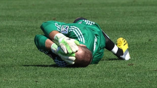 Goalie Stefan Frei is injured after collides with forward Ethan Finley of the Columbus Crew on Saturday.