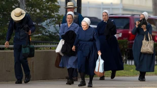 Sixteen members of an Amish community were convicted Thursday of hate crimes for a series of hair- and beard-cutting attacks.