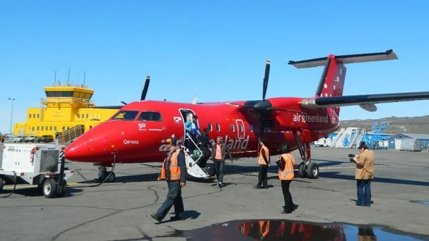 Passengers exit an Air Greenland Dash 8 after arrival at the Iqaluit airport from Nuuk in 2012.