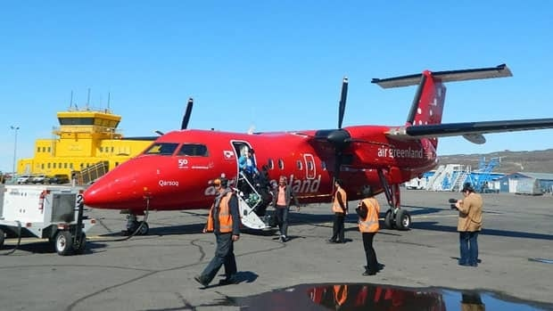 Passengers exit an Air Greenland Dash 8 after arrival at the Iqaluit airport last summer.