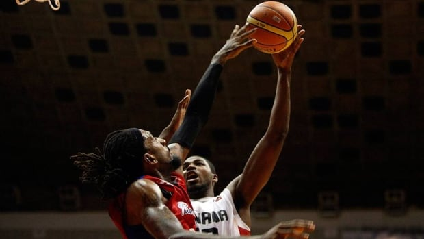Canada's Tristan Thompson, right, goes up for a shot at the Marchand Cup basketball game in Puerto Rico on Aug. 22. Thompson and his teammates open the FIBA Americas Championship on Friday against Jamaica in Caracas, Venezuela.