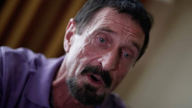 John McAfee, anti-virus software guru, wants to return to the United States with his 20-year-old Belizean girlfriend.