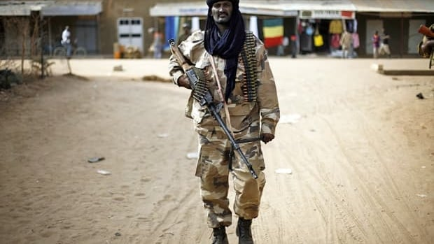 Chadian troops patrol the streets of Gao, northern Mali, on Tuesday, days after Malian and French military forces closed in and retook the town from Islamist rebels.
