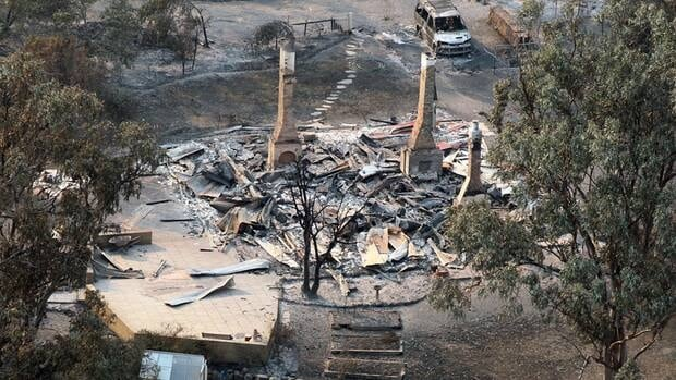 A house destroyed by a bushfire is seen in ruins in Dunalley, about 40 kilometres east of Hobart, Tasmania. Over 100 homes have been destroyed in the state of Tasmania, with police saying that thousands of residents have been displaced by dozens of bush fires.