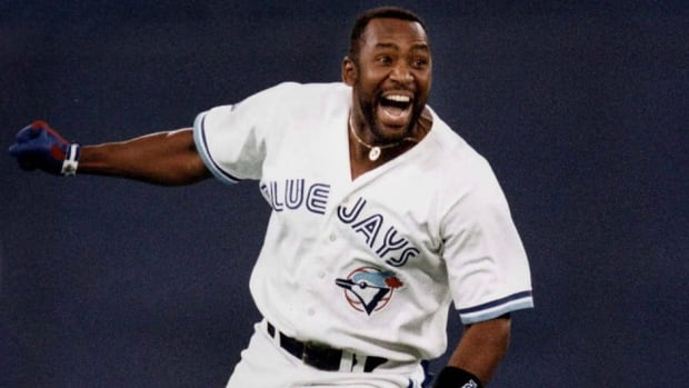 Toronto Blue Jays' Joe Carter is seen here in this iconic photo celebrating his game-winning home run to win the 1993 World Series. Carter says that baseball players that have used performance-enhancing drugs have devalued what Carter and players like him accomplished without drugs.