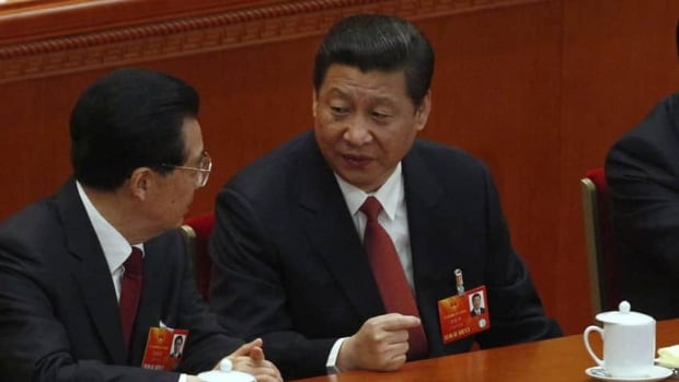 China's newly-elected President Xi Jinping, right, talks with China's former President Hu Jintao during the fourth plenary meeting of National People's Congress (NPC) at the Great Hall of the People in Beijing. China's parliament formally elected Xi as the country's new president on Thursday, succeeding Hu, putting the final seal of approval on a generational transition of power.