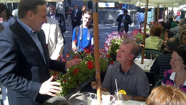 CAQ Leader François Legault mixes with the lunch crowd in Quebec City this week.