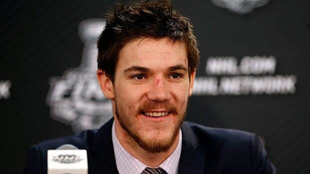 Andrew Shaw of the Chicago Blackhawks smiles while answering questions from the media at a post game press conference for Game 1.