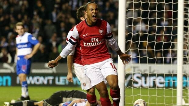 Theo Walcott of Arsenal celebrates their sixth goal during the fourth round match at Madejski  Stadium in Reading, England. (Photo by Scott Heavey/Getty Images)