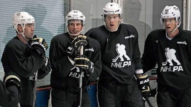 Pittsburgh Penguins hockey players, from left, Pascal Dupuis, captain Sidney Crosby, Ben Lovejoy and Tyler Kennedy will be getting ready for game shape in the next week or two.