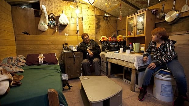 Donald Jacasum talks with Jessica Jacasum in a temporary shelter in Attawapiskat in November, 2011. On Wednesday, the Federal Court said it was unreasonable for a third-party manager to be appointed by the federal government in response to a housing shortage in the community.