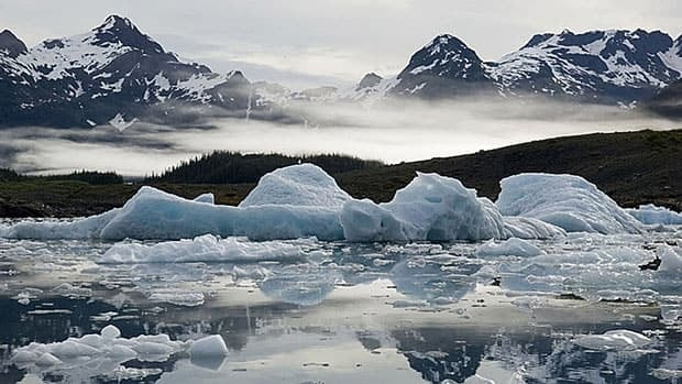 The Columbia Glacier calves icebergs into Columbia Bay west of Valdez, Alaska. The ice shown in the bergs was deposited in snowstorms 300 to 500 years ago.