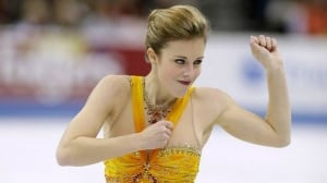 Ashley Wagner smiles as she competes in the ladies free skate program at the U.S. figure skating championships, Saturday in Omaha, Neb.
