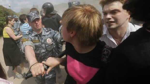 Riot police detain gay rights activists during their rally in St. Petersburg, Russia, on June 29, which proceeded with official approval despite recently passed legislation targeting gays. The law has led to calls for a boycott of the 2014 Olympic Games in Sochi.