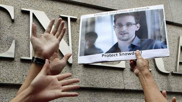 A supporter holds a picture of Edward Snowden, a former CIA employee who leaked top-secret information about U.S. surveillance programs, outside the U.S. consulate general in Hong Kong on Thursday.