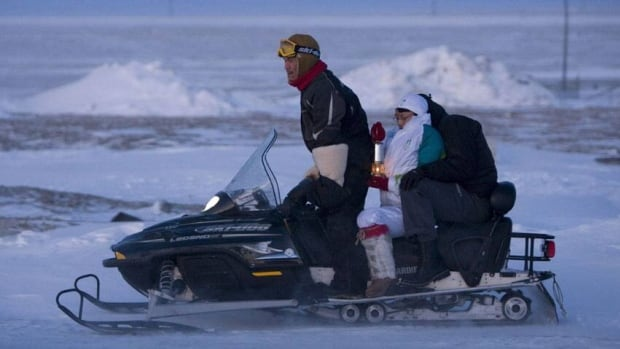 Torchbearer Brenda Eckalook carries the Olympic Flame atop a Ski-Doo in Resolute Bay, NU., in Nov. 2009. The Quebec-based maker of Ski-Doo snowmobiles, personal watercraft and all-terrain vehicles have announced plans to launch an initial public offering.