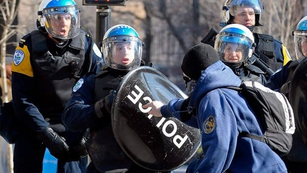 Clashes between protesters and riot police are a regular feature of Montreal's anti-police brutality march.