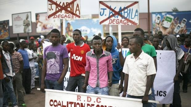 Goma residents including street children gather Wednesday for an anti-Kabila demonstration supported by the M23 rebel movement in Goma, where Congolese residents are receiving mixed messages about a rebel withdrawal from the city.
