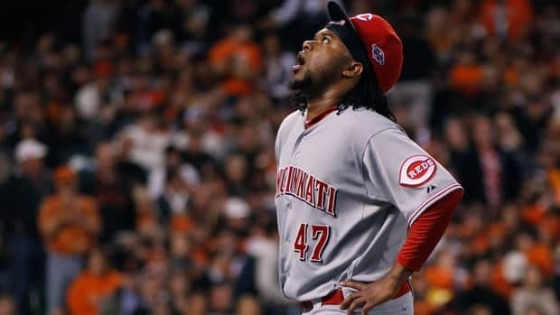 Reds starting pitcher Johnny Cueto reacts after being forced to leave Game 1 against the Giants with back spasms. His status for a potential Game 4 in the NL Division Series remains unclear.