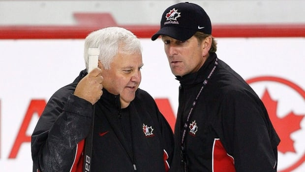 "Associate coach Ken Hitchcock, left, and head coach Mike Babcock, right, seen here at Team Canada's Olympic men's hockey orientation camp in 2009, are very similar in how they think the game. ""When the [Olympic] competition starts, we both speak in very pointed terms and very brief sentences and we have a good relationship because of that,"" Hitchcock says."