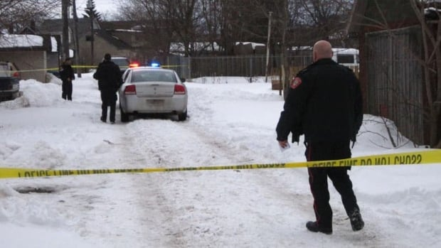Police investigate the area where a man's body was found late Thursday afternoon.