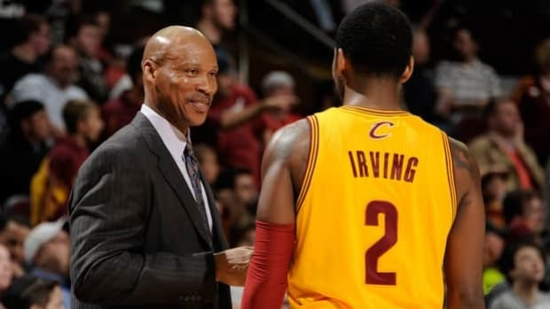 Byron Scott, left, posted a 64-166 record as Cavaliers head coach, including 24-58 this season.