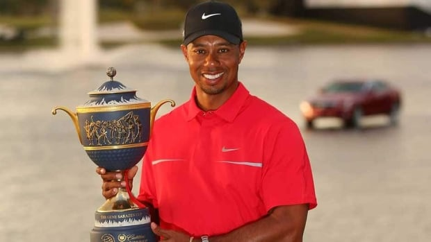 Tiger Woods poses with the Gene Sarazen Cup after his two-stroke victory at the World Golf Championships-Cadillac Championship at the Trump Doral Golf Resort & Spa on Sunday in Doral, Fla.