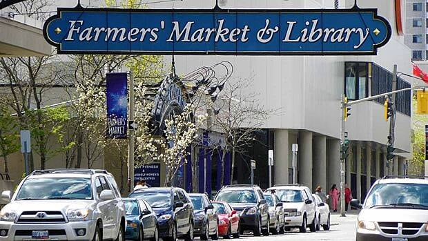 This sign advertising the Hamilton farmers' market and public library appears to be gone forever.