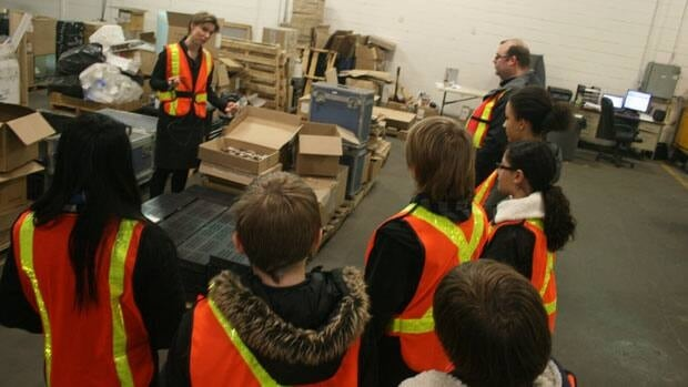 REfficent CEO Stephanie McLarty will guide Memorial School's grade eights through thier entrepreneurial adventure. The students visited her warehouse Monday.