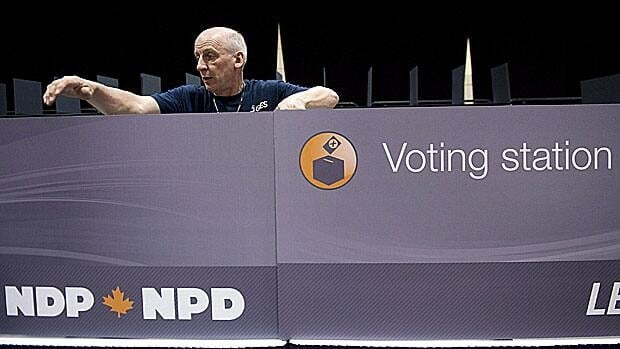 A worker constructs a voting station as the NDP gets ready for the party leadership convention in Toronto on Wednesday, March 21, 2012. Liberal Party supporters may be watching to see how the new NDP leader could affect their own chances.