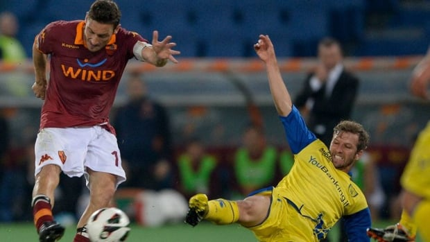 AS Roma forward Francesco Totti, left, controls the ball against Chievo's Perparim Hetemaj during their match on Tuesday at Rome's Olympic stadium.