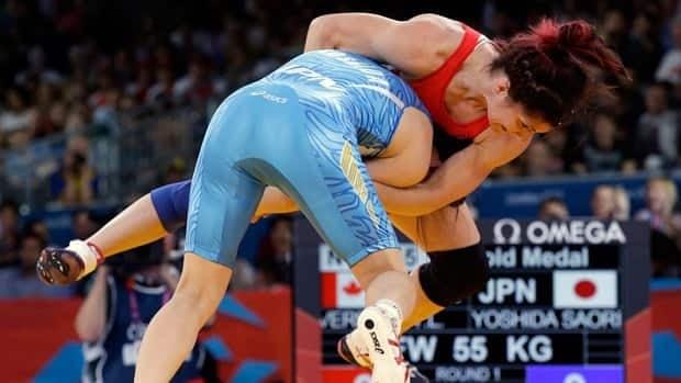 Tonya Verbeek, in red, battles Japan's Saori Yoshida in the 55-kilo gold-medal bout in London.