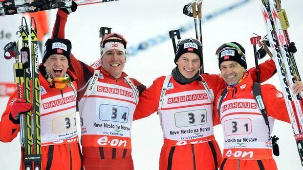 From left to right, Tarjei Boe, Emil Hegle Svendsen, Henrik L'Abee-Lund and Ole Einar Bjoerndalen celebrate after winning the men's 4x7.5-kilometre relay on Saturday.