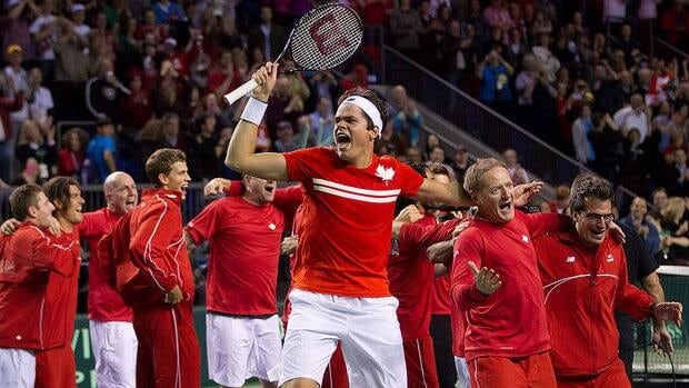 Milos Raonic celebrates with his Canadian teammates after defeating Italy's Andreas Seppi in their Davis Cup quarter-final singles match Sunday. Canada will play in the semifinals in September for the first time in the modern era.