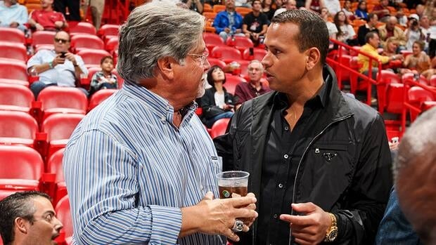 Alex Rodriguez, right, of the New York Yankees is seen here speaking with Micky Arison, owner of the Miami Heat, before an NBA game between the Heat and the Washington Wizards on Sunday.