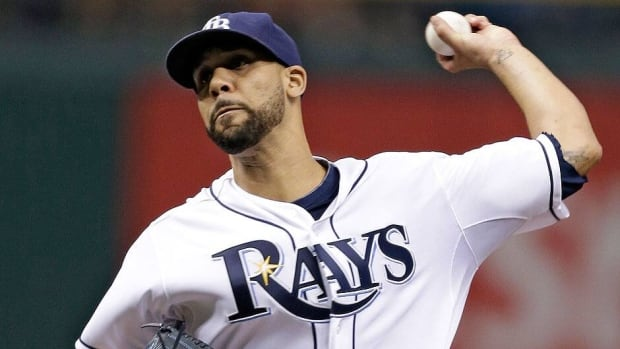 Rays starting pitcher David Price, seen here delivering a pitch Wednesday night against Boston, departed with one out in the third inning with left triceps tightness.