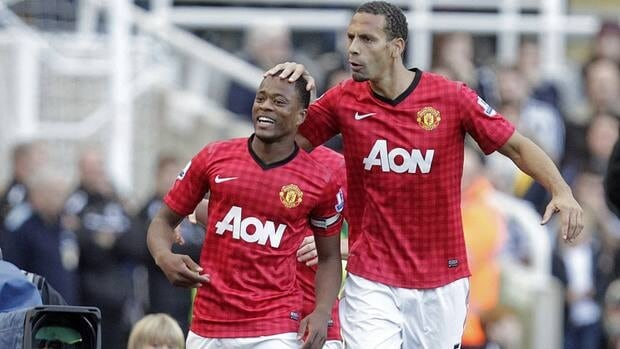Manchester United defender Patrice Evra, left, celebrates with defender Rio Ferdinand after scoring their second goal during their match against Newcastle on Sunday.