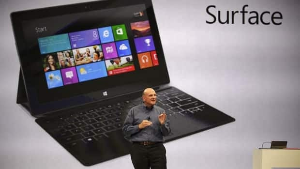 Microsoft CEO Steve Ballmer introduces Microsoft's new tablet Surface. The tablet comes with a kickstand to hold it upright and keyboard that is part of the device's cover.