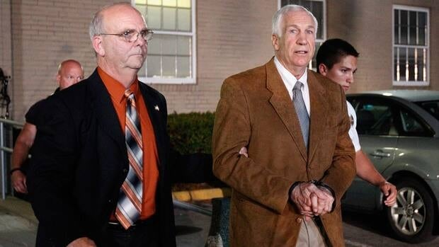 Former Penn State assistant football coach Jerry Sandusky leaves the Centre County Courthouse in handcuffs after a jury found him guilty in his sex abuse trial on June 22, 2012 in Bellefonte, Penn.
