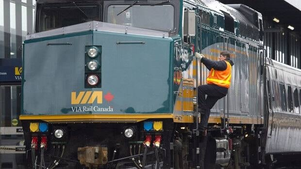 A VIA Rail employee climbs aboard an F40 locomotive at the train station in December.