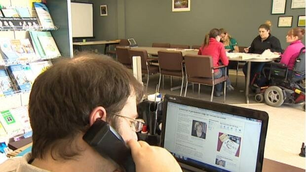 Volunteers work in the Coalition of Persons with Disabilities office in St. John's.