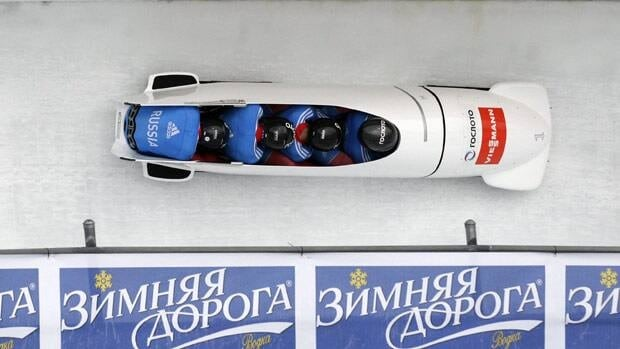 Russia 1 pilot Alexander Zubkov, right, and his teammates won the World Cup stop in Utah on Saturday.