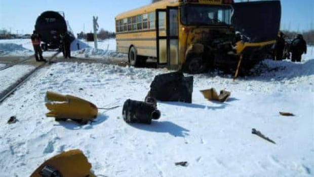 One child received minor scratches after a train collided with this school bus in Carlyle, Sask.