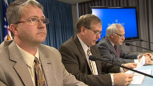 N.L. justice minister Darin King, environment minister Tom Hedderson, and aboriginal affairs minister Felix Collins at a news conference about the George River caribou herd on Monday.