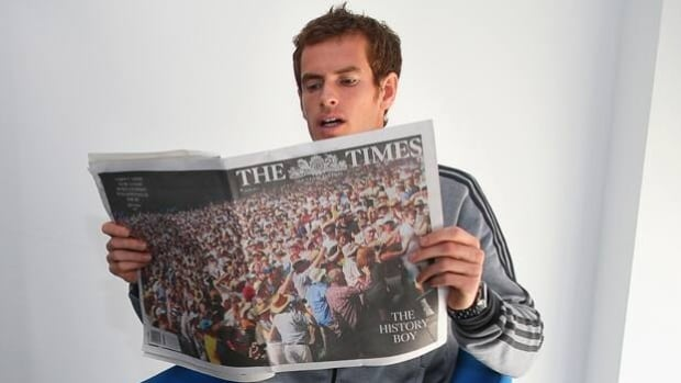 Andy Murray reads about his exploits at Wimbledon in the morning newspapers on Monday.
