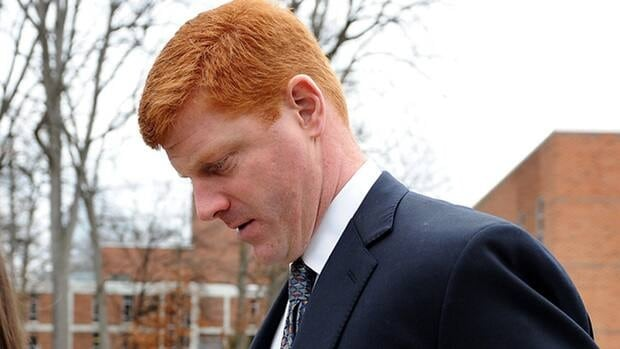 In this file photo from Jan. 24, 2012, Mike McQueary walks outside after paying respect to former Penn State coach Joe Paterno during the public viewing at the Pasquerilla Spiritual Center on Penn State.