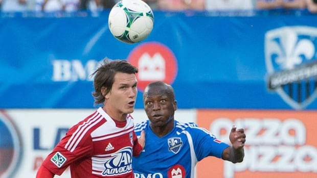 FC Dallas Conor Shanosky left, battles Montreal Impact's Sanna Nyassi, right, for possession of the ball during the first half Saturday.
